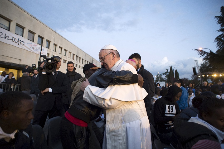 Pope Francis embraces a refugee after a foot-washing ritual at the Castelnuovo di Porto refugees centre near Rome, Italy, in this March 24, 2016 handout photo by Osservatore Romano. REUTERS/Osservatore Romano/Handout via Reuters ATTENTION EDITORS - THIS PICTURE WAS PROVIDED BY A THIRD PARTY. REUTERS IS UNABLE TO INDEPENDENTLY VERIFY THE AUTHENTICITY, CONTENT, LOCATION OR DATE OF THIS IMAGE. EDITORIAL USE ONLY. NOT FOR SALE FOR MARKETING OR ADVERTISING CAMPAIGNS. NO RESALES. NO ARCHIVE. THIS PICTURE IS DISTRIBUTED EXACTLY AS RECEIVED BY REUTERS, AS A SERVICE TO CLIENTS.