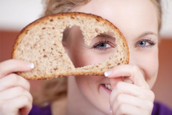 women-piece-bread-heart